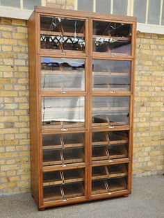 Mahogany fronted haberdashery cabinet. Great quality and compact size. Removed from a gentleman's outfitters in Covent Garden.  origin: Covent Garden, London  year: 1930