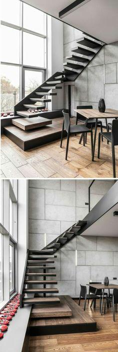 escalier design en métal noir et marches en bois marron foncé, garde corps en métal noir, maison à deux étages en style industriel