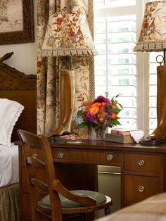 Minus the boot lamps, love the idea of grandpa's desk in between two beds in the guestroom.  Also those headboards are my favorites!  Just different lamps, LOL.  Be My Guest