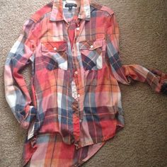 Urban Outfitters Flannel Bought from Urban Outfitters. Perfect condition. Very cute high low cut. Soft light weight material. Plaid is burnt orange, navy, cream and red. Happy to take offers! Urban Outfitters Tops Button Down Shirts