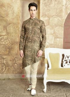 Rock any festive function by wearing this Dark khaki color Cotton Pathani enhanced with Stylish Buttons Work. Also comes with Beige Color cotton silk fabric Trouser. Mens Indian Wear, Mens Ethnic Wear, Indian Groom Wear, Indian Men Fashion, Mens Fashion Wear, Mens Shalwar Kameez, Kurta Men, Mens Kurta Designs, Wedding Dresses Men Indian