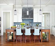 Kitchen Blues    Add color through accessories and accents to amp up any room. In this classic white kitchen, a blue brick backsplash above the range and a trio of soft blue chairs along one side of the island introduce color to the elegant space. The hues also complement the cool tones featured in the countertops and vent hood.