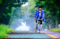 lee shin riding bicycle in jeju island