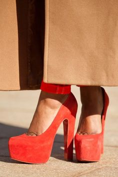 Classic combo, camel and red gets a lift with cherry Louboutin platforms.