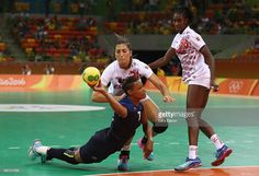 Allison Pineau of France is challenged by Lara Ortega Gonzalez of Spain during…
