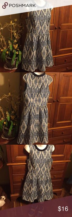 Jessica Simpson dress Summery sleeveless Jessica Simpson dress Blues and white Aztec print. Navy braided banding around the neck. 2 side pockets. Zips and hooks in the back of dress. Size 10.  Excellent condition. Will iron prior to shipping  :-) Jessica Simpson Dresses Midi
