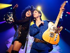 ANDY ALLO and Prince The two singers feel the music at a 2011 performance in Rotterdam, Netherlands.