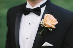 Simple peach roses and baby's breath boutonniere.  |  http://www.stylemepretty.com/2014/10/21/glamorous-pink-khorassan-ballroom-wedding/