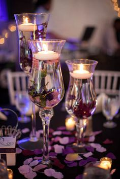 Romantic Touches Dana Nigro at Village by the Gardens created the couple's romantic reception décor. She used footed candleholders with floa...