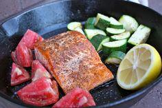 Cast Iron Pan Seared Salmon - extra virgin olive oil - kosher salt - fresh cracked pepper - salmon fillet - zucchini - tomato - lemon