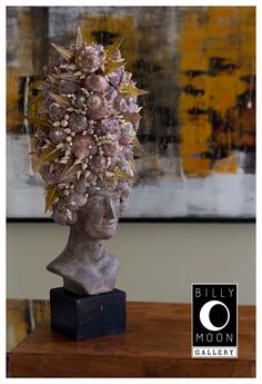 Head Sculpture. Terracotta female head. Assorted shell decoration. Recycled glass droplets. Wood base. A1356
