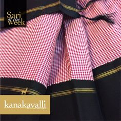 An attractive​ pattern ​of tiny checks ​in pretty pink and subtle white covers the entire expanse of this ravishing Kanakavalli Kanjivaram. This vintage pattern is elevated by the striking black pallu adorned by slim bands of zari woven with the cherished Korvai pattern​. ​Our Sari of the week ​is a must-have on your festive shopping 'check'-list.
