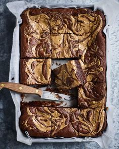 Gooey, rich chocolate brownies made better with a swirl of salty peanut butter. The trick to creating the perfect fudgy brownie is to bake the batter only until it still has a wobble to it.