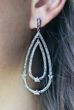 No need to cry. The diamond tear drop earring will ease your troubles and dazzle your ears in one quick step. Made with oxidized sterling silver pave diamonds, the Double Tear Drop Earring will lift y