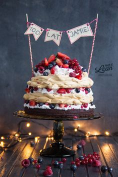 meringue cake with brownie base, coconut cream & red fruits (pale) -- add pom poms? ombre cake with glittered mallows, cookies around perimeter and pom poms?
