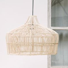 A favourite with White Moss, we love this stunning, unique design with the 'double belly' effect and the delicate lattice, hand woven by Balinese artisans in lightly bleached natural rattan. Make a statement in any room with this elegant pendant light shade.