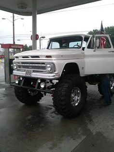 Classic vintage white lifted Chevrolet truck