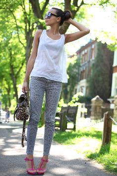looking fab in gray leopard print jeans and pink sandals add fun and femininity