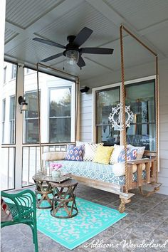 A vibrant mattress cover and assortment of brightly-colored pillows creates a boho chic statement in this outdoor entertaining space.Click through more cool DIY outdoor swings. Porch Swing Bed, Home, Outdoor Spaces, Outdoor Space, Hanging Beds, Outdoor Bed Swing, Vintage Porch Swings, Porch, Porch Bed