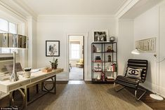 From the living room is an office/study which shares a Jack-and-Jill bathroom with a small bedroom set up as a sitting room