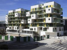 """26. Les Nids GÇô Courbevoie, FranceThe brief for this social housing project in the relatively new urban development zone that is Les Fauvelles in Courbevoie, France was that it should """"present new approaches for social housing in densely occupied urban settings."""" Paris-based KOZ Architects responded with Les Nids, a two-block complex that includes innovative features such as different shaped apartments, large landings and lots of external spaces, offering residents airy views of nearby…"""