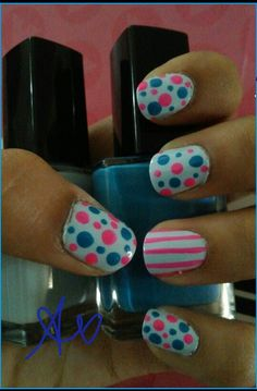 Fun nail design with hot pink and blue polka dots and hot pink stripes on the ring finger Design done by me:  Aylin Vazquez mexicanbarbie1