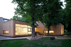 Completed in 2010 in Guntramsdorf, Austria. Images by Kurt Hoerbst. The kindergarten is located in a grove of striking chestnut trees. Its rustic design celebrates a sense of open space and connection with its lovely. Daycare Rooms, Home Daycare, Daycare Ideas, Learning Spaces, Learning Centers, Early Learning, Education Architecture, Architecture Design, School Building