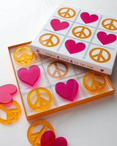 """""""Peace & Love & Tic Tac Toe"""" Set by Jonathan Adler. Bright orange peace symbols and hot-pink hearts with a distinctive 60s vibe."""