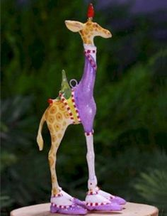 Patience Brewster Krinkles Mini George Giraffe Ornament 08-30952.  Appropriately decked out in his purple and white finery!  So whimsical!