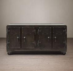 RH's 20Th C. Iron Vault Sideboard:Modeled on the stalwart safes that were a fixture in turn-of-the-last-century jewelry shops and factory offices, our furnishings are crafted from steel sheet and fitted with latching doors and heavy-duty metal wheels.
