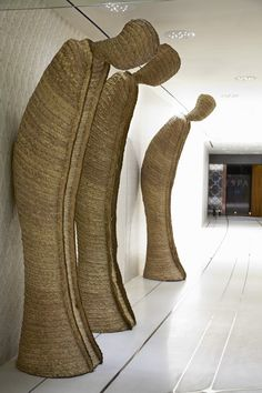 Bowing sculptures line the hallway at Yas Viceroy Abu Dhabi