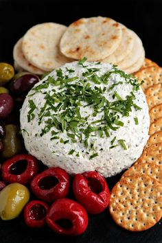 "~ ""Feta Cheese Ball""...    Yield: 30 servings    Prep Time: 15 minutes  Ingredients:    2 (8 ounce) packages cream cheese, softened  4 ounces feta cheese, crumbled  2 tablespoons olive oil  2 green onions, finely chopped  2 cloves garlic, minced  2 1/2 teaspoons dried oregano  freshly cracked black pepper to taste"