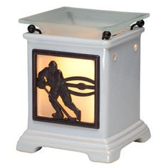 Slapshot Full-Size Scentsy Warmer PREMIUM - Celebrate your love for hockey with Slapshot, featuring a picture window set into a square taupe column. Switch it on, and the glow from within sets off the silhouette of a hockey player ready to score. Hockey Gifts, Hockey Mom, Hockey Stuff, Hockey Decor, Bruins Hockey, Hockey Bedroom, Hockey Season, Wax Warmers, Scented Wax