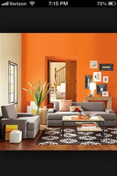Grey and orange room. I like these colors for my salon. Not much work needed...