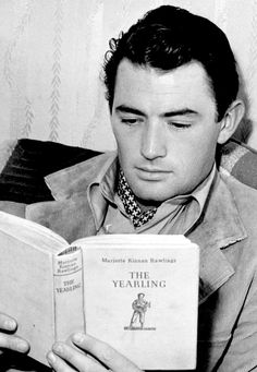 Gregory Peck reading the novel on the film set of 'The Yearling' 1946