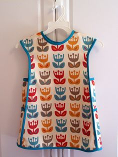"Bias-trimmed apron from instructions in the sewing book ""Little Things to Sew."" Tulip print by Jessica Jones."