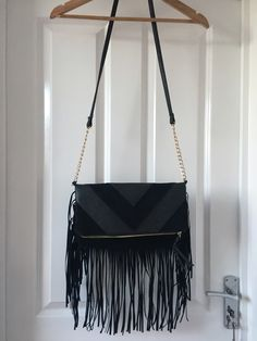 7396e2e050fec0 Black with suede and black leather with crocodile detail. Long fringe Chain  detail on strap