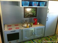 DIY play kitchen from old tv cabinet. Cool!