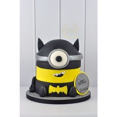 Batman Themed Minion Cake! ❤ liked on Polyvore featuring food