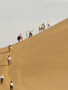 Climbing Dune 7 in Walvis Bay, Namibia on a luxury cruise excursion is a fun travel adventure.