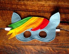 Beautiful Handmade Rainbow Dash Mask. Everyone's favourite My Little Pony! Perfect for inspiring imaginative play. Made from lovely soft merino felt.
