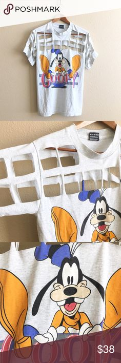 Goofy Gridlock Tee Vintage Goofy tee with grid cutout. One of a kind!  BRAND: Screen Stars MATERIAL: 50/50 YEAR/ERA: 90s LABEL SIZE: S BEST FIT: S  MEASUREMENTS: Chest 17 inches Length 25.5 inches   *Listed as LF for search visibility. *Price firm unless bundled.  🚫 I do not model or trade, sorry! 💟 Check out my closet for more vintage tees!     0083 LF Tops Tees - Short Sleeve