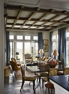beams (rustic, side-by-side with a white boxed ceiling treatment as well), beautiful blue