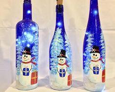 Ready to Ship Snowman Christmas Bottle Light, Blue Bottle Light, Christmas D by BringtheJoyCreations via Wine Bottle Art, Painted Wine Bottles, Lighted Wine Bottles, Painted Wine Glasses, Bottle Lights, Wine Bottle Crafts, Blue Bottle, Personalized Family Ornaments, Christmas Wine Bottles
