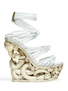 Fashionable footwear, or wearable art? You decide with these Asian-inspired platforms by Pucci.