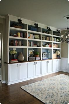 She used unfinished wall cupboards on the bottom, then built the shelving from 1 x Might be a solution for built ins in family room off the kitchen Bookshelves Built In, Diy Bookcases, Book Shelves, Glass Shelves, Bookshelf Ideas, Built In Shelves Living Room, Bookshelf Decorating, Bookshelf Makeover, Build In Shelves