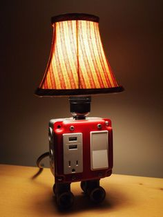 Charge your devices and give off some warm lighting in your home or office with this clever USB charger outlet lamp. Available in a several different colors, this unique forty watt lamp doubles as a electrical outlet and USB charger station. Desk Light, Lamp Light, Usb Lamp, Usb Charging Station, Table Vintage, Ideias Diy, Luminaire Design, Pipe Lamp, Bedroom Lamps