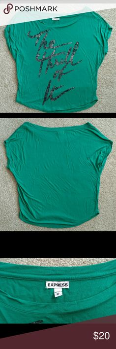 "Green Express Short Sleeve Batwing Top Express Brand Green ""The Thrill of It"" Short Sleeve Batwing Style Loose  *Tags Express, Green, Teal, Graphic Tee, T-shirt, Charlotte Russe, Urban Outfitters, American Eagle, Obey, Volcom, Roxy, Billabong, Zumiez, Wet Seal Express Tops Tees - Short Sleeve"
