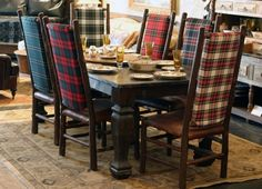 Whether you have identical dining chairs or a mixture you can bring the tartan theme into play by bringing the whole ensemble together using the same or a variety of tartans and plaids.I would totally have a tartan chair or bench!