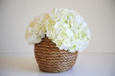 Natural rope pairs beautifully with big, white blooms. All you need is a glue gun to recreate this look. Get the how-to from Cupcakes and Cashmere »  - GoodHousekeeping.com